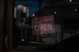A photo of an open for business sign for the Unwanted Life Shop