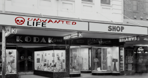 A black and white photo of old store fronts to represent the site - Unwanted Life Shop